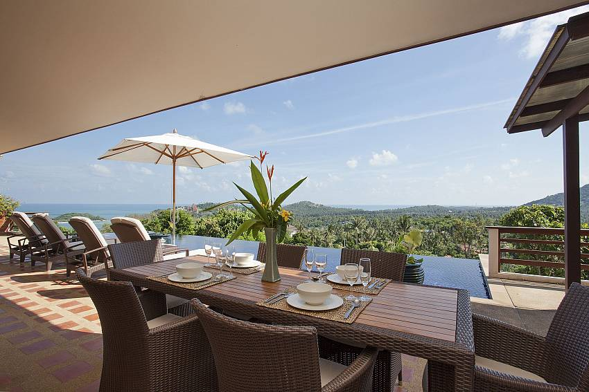 Outdoor dining by the pool with sea view at Cape Summitra Villa Koh Samui