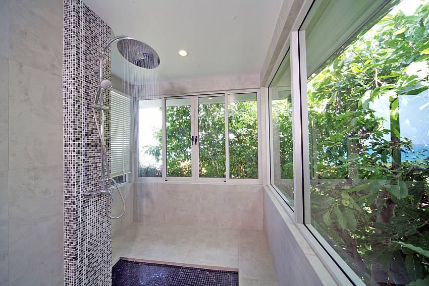 Shower overlooking the trees Of Summitra Villa No.3