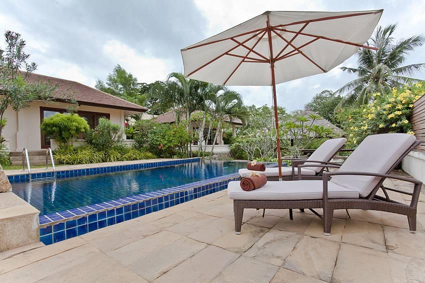 Sun bed near the pool Of Summitra Pavilion Villa No.10