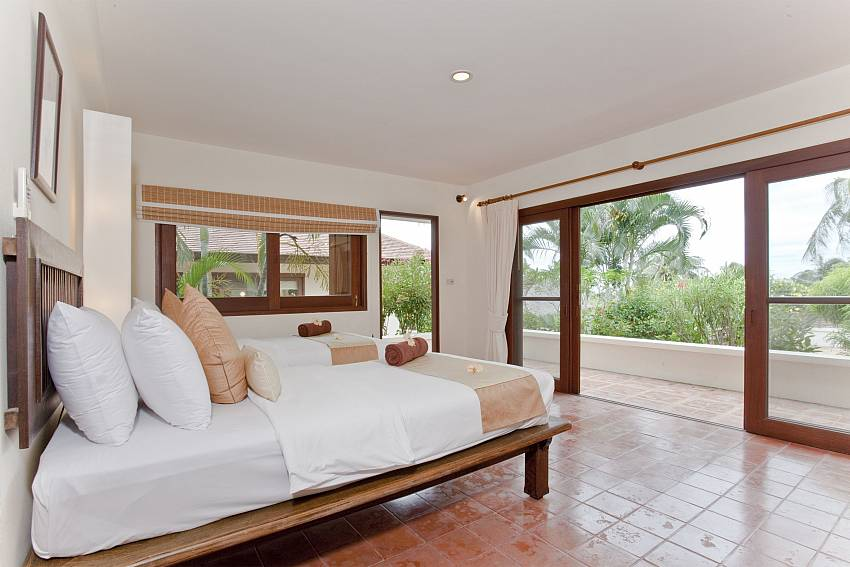 Direct garden access from the twin bedroom at Summitra Pavilion Villa No. 10 in Koh Samui