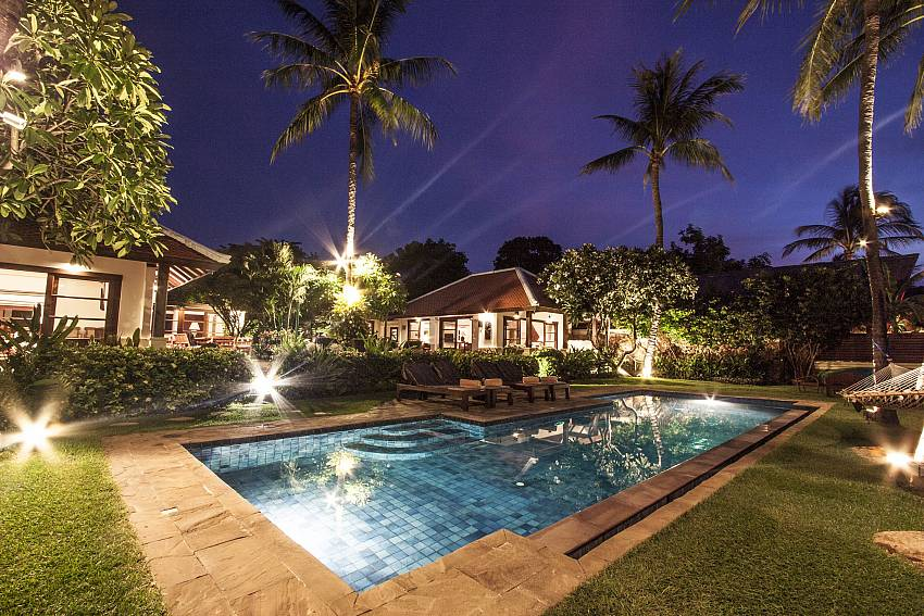 Swimming pool at night time Of Bangrak Beachfront Villa