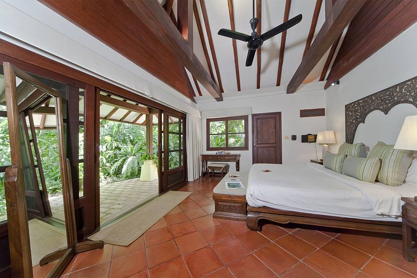 Bedroom overlooking outdoor Of Bangrak Beachfront Villa (six)