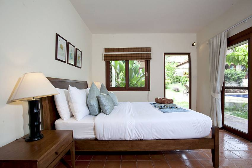 Comfy king size bed with direct garden access at Summitra Pavilion Villa No. 3 in Koh Samui