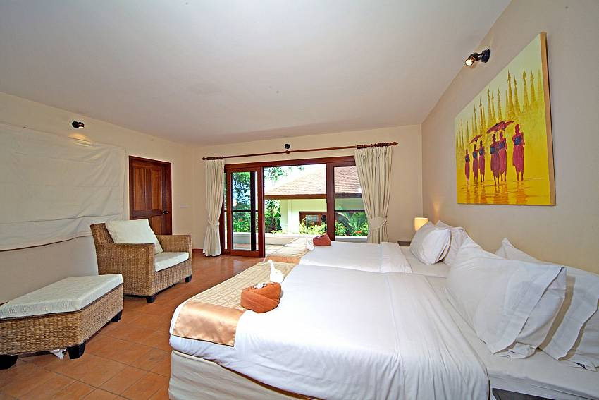 Double bedroom with sofa see view Of Summitra Pavilion Villa No. 9