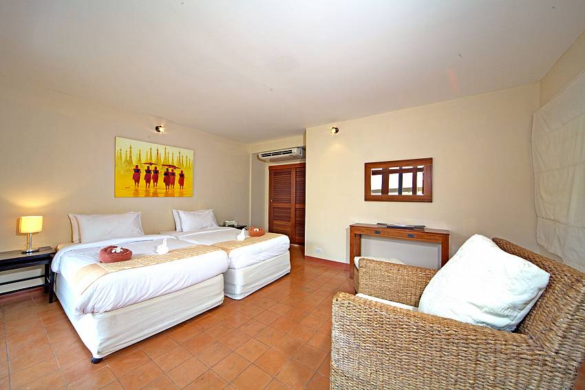 First bedroom with twin beds at Summitra Pavilion Villa No. 9 in Samui