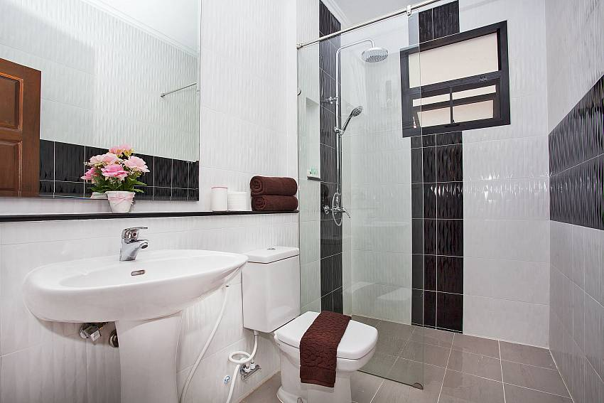 All the bathrooms are modern in Debonair Grande Villa South Pattaya