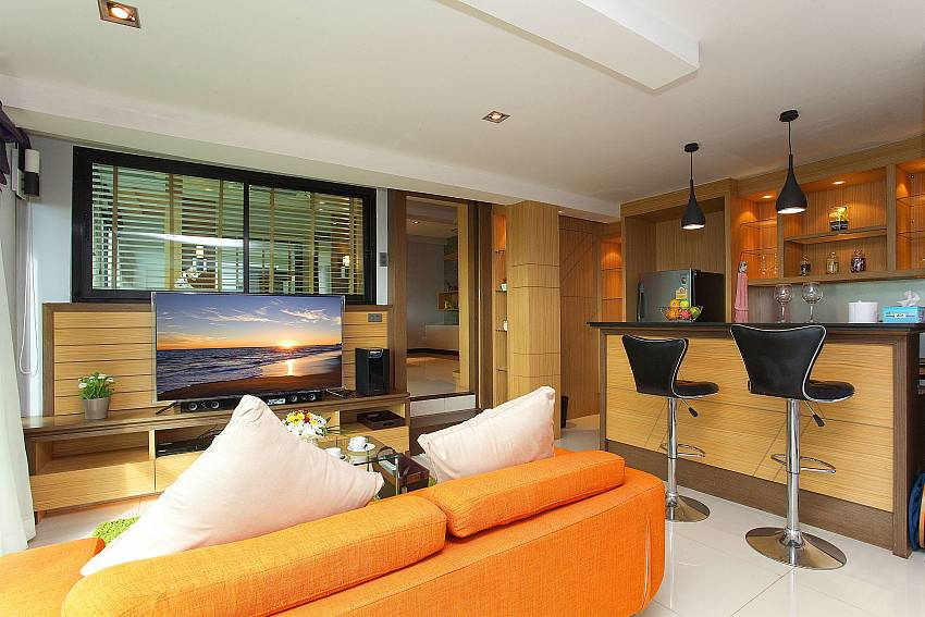 Living room with TV and small bar at Krabi Sunset Hill Villa in No Nang Krabi