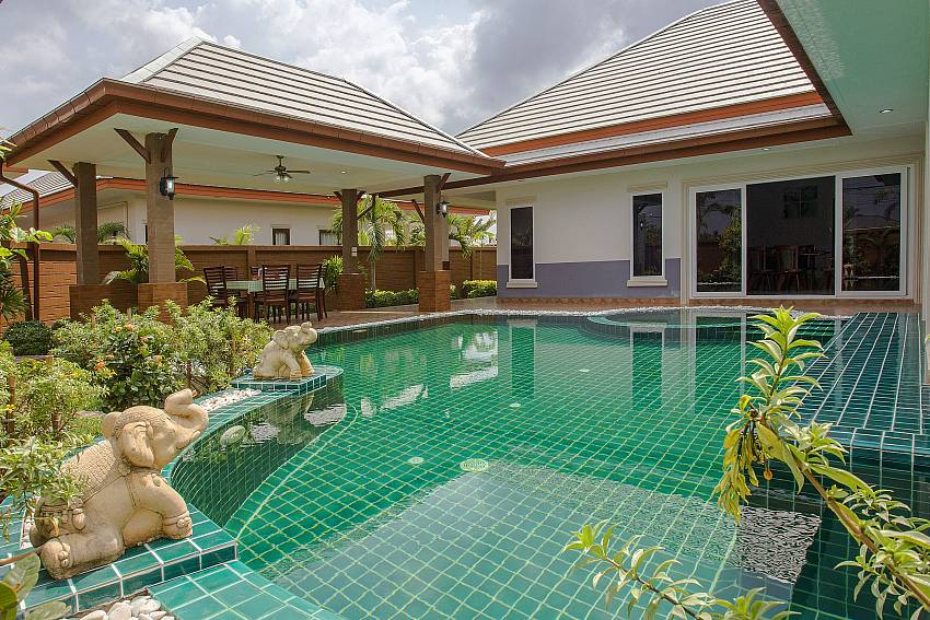 The pool is decorated with trees and sculpture Of Thammachat P3 Victoria