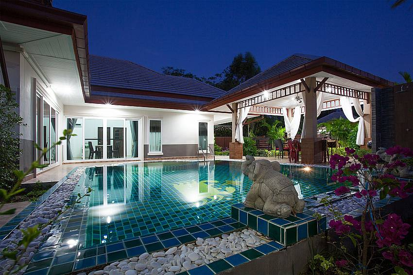 Relax by the private pool at night in Thammachat P3 Vints 130 Pattaya
