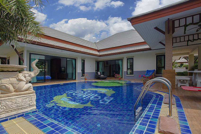 The pool is decorated with trees and sculpture Of Thammachat P2 Tani