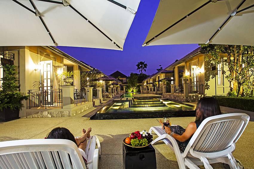 Sun bed near the pool at night time Of Sala Retreat Villa