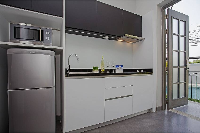 Refrigerator with microwave in the kitchen Of Sala Retreat Villa