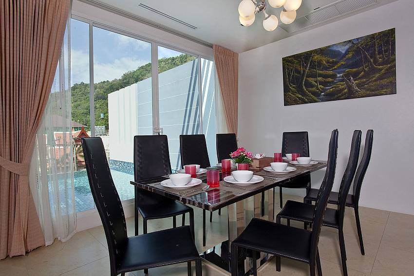 Dinning table in the house near the pool Of Kata Horizon Villa B1