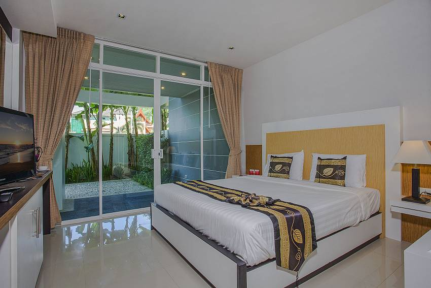 Bedroom with TV near the pool Of Kata Horizon Villa B1 (Third)