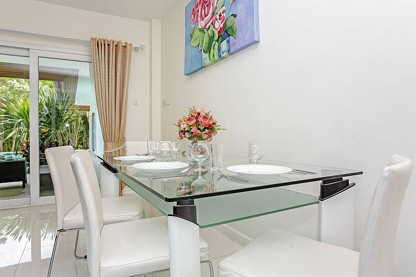 Dinning table in the house Of Rossawan Pool Villa