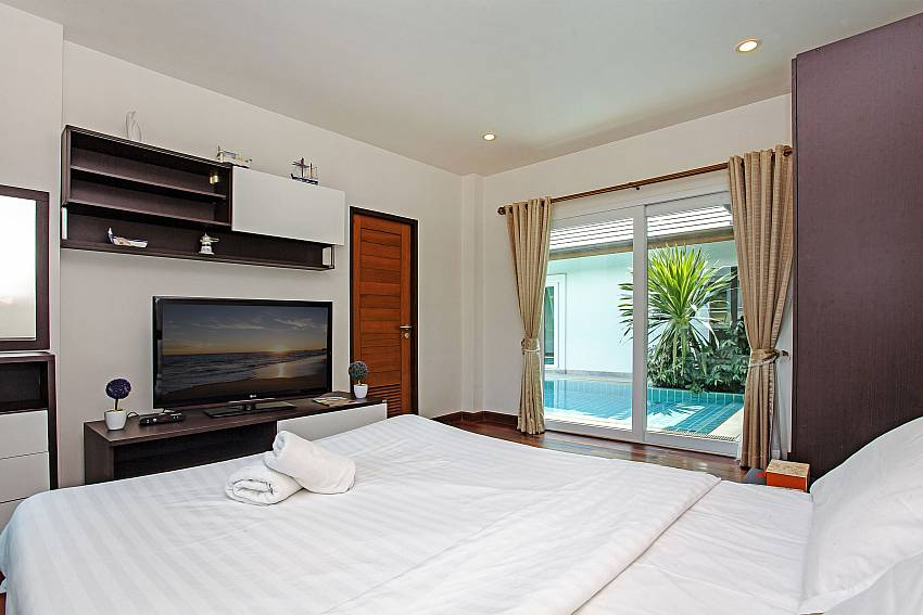 Bedroom with TV and shelves Of Rossawan Pool Villa (Third)