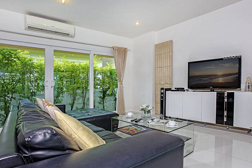 Stylish living area with TV at Rossawan Pool Villa Pattaya