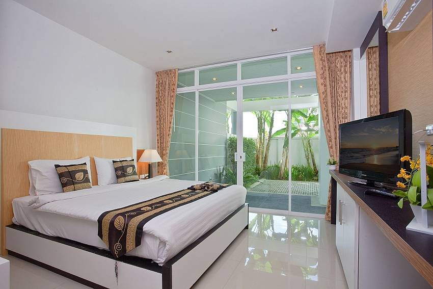Bedroom with TV near the pool Of Kata Horizon Villa B2 (Second)