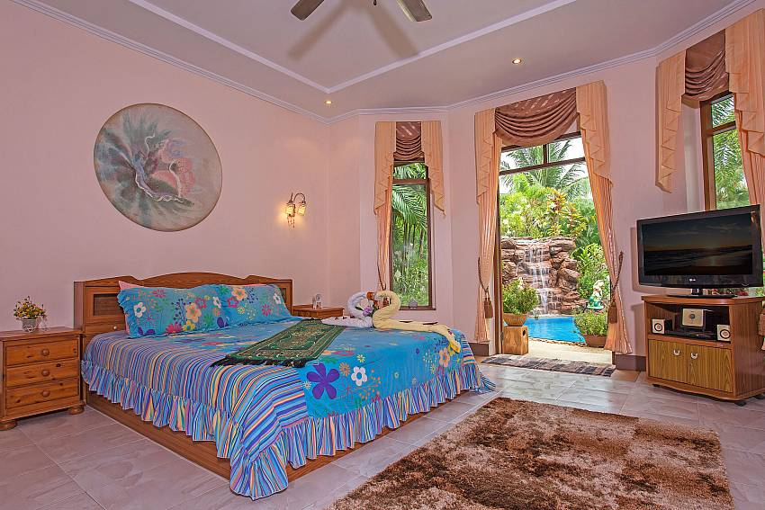 Bedroom colorful see view with TV Of Relaxing Palms Pool Villa (First)