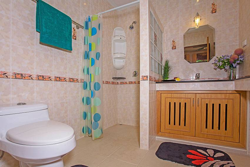 Toilet with shower and basin wash Of Relaxing Palms Pool Villa