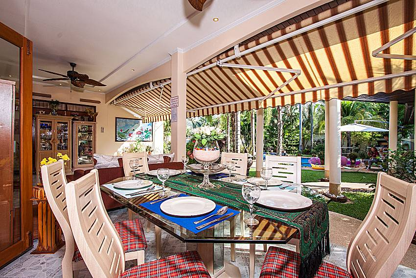 Dinning table outdoor see view Of Relaxing Palms Pool Villa