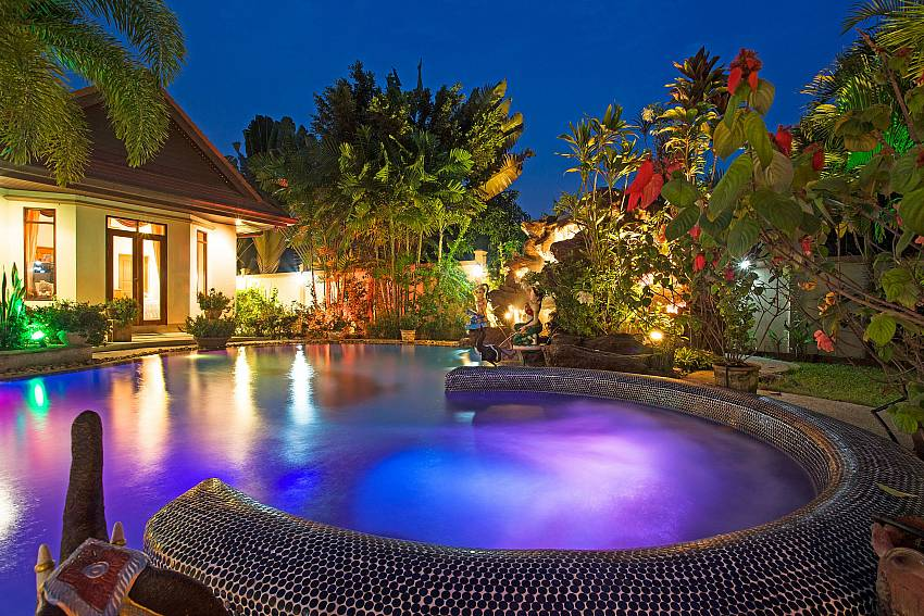 Swimming pool at night time Of Relaxing Palms Pool Villa