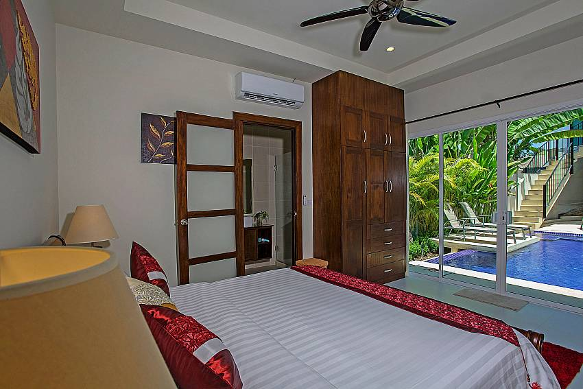 Bedroom with wardrobe near the pool Of Rawayana Pool Villa (Third)