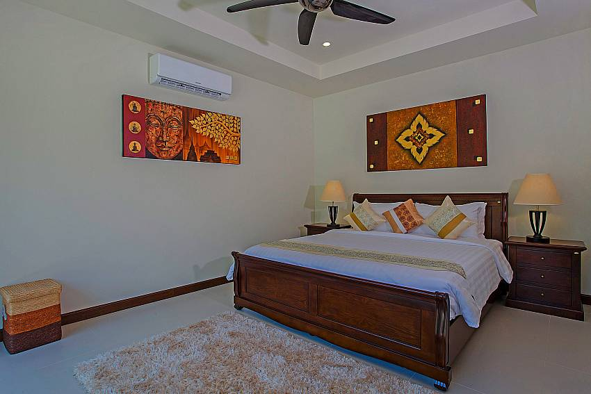 Bedroom is decorated with beautiful pictures Of Rawayana Pool Villa (Four)