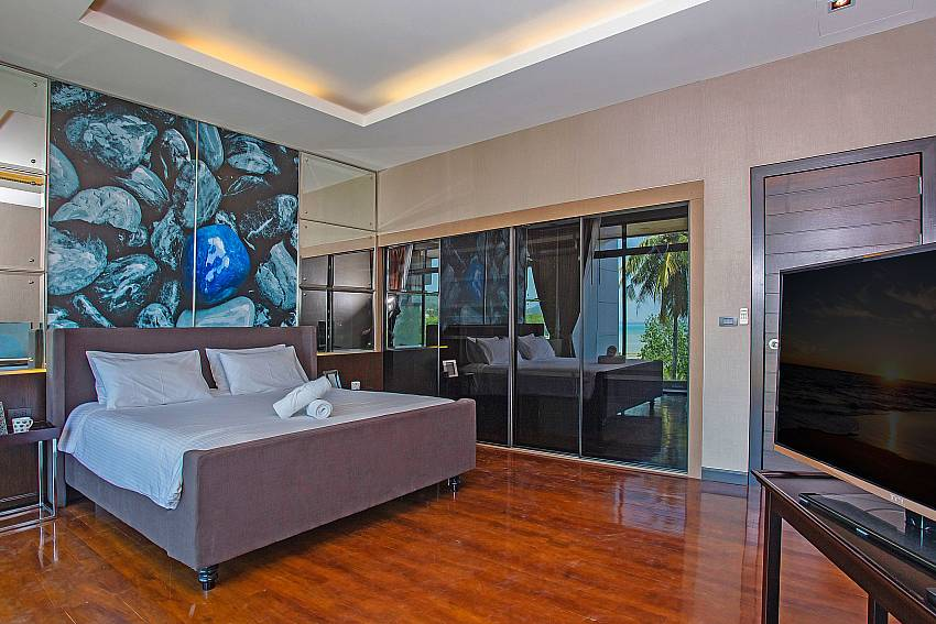 Bedroom with TV is decorated with picture of art Of Equilibrium Rawai Villa (First)