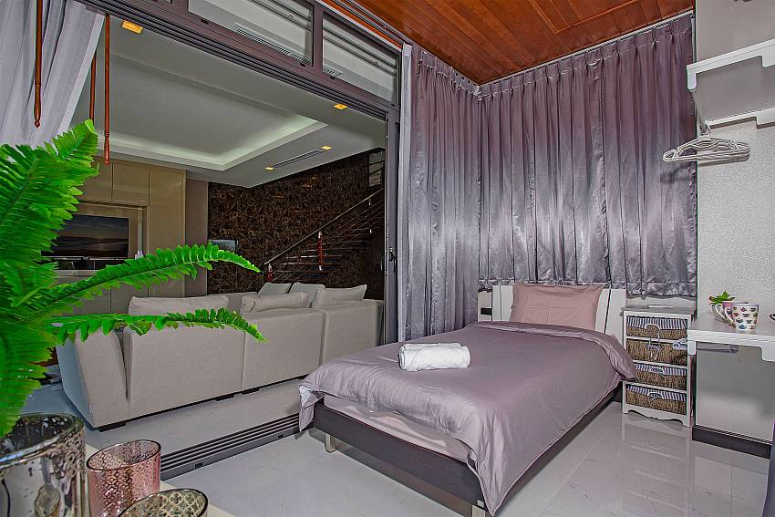 Bedroom bright purple near the living room Of Equilibrium Rawai Villa (Four)