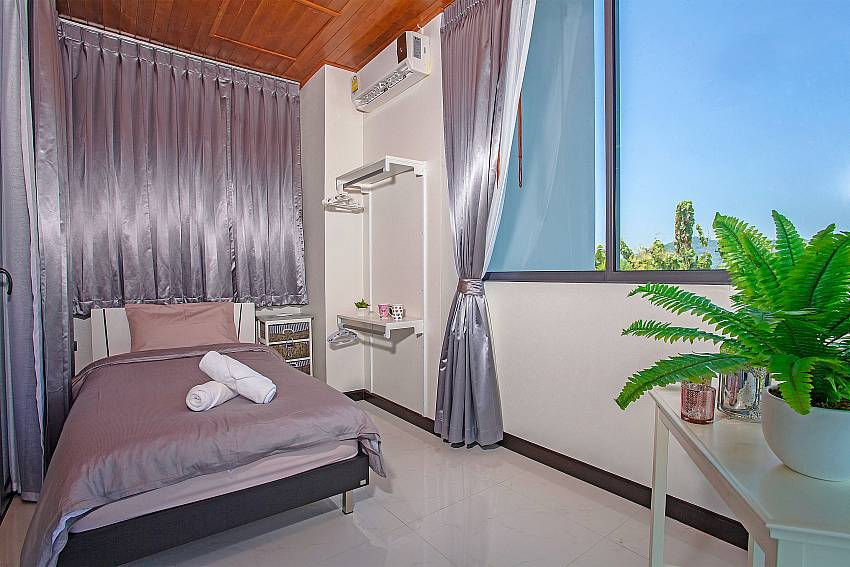 Bedroom bright purple views Of Equilibrium Rawai Villa (Four)