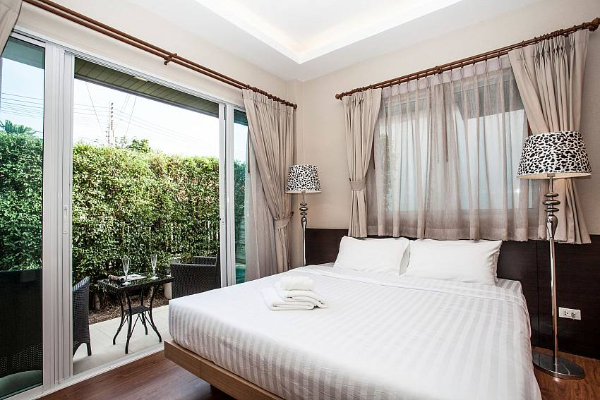 Direct garden access from bedroom at Jomtien LAmore Villa in Pattaya