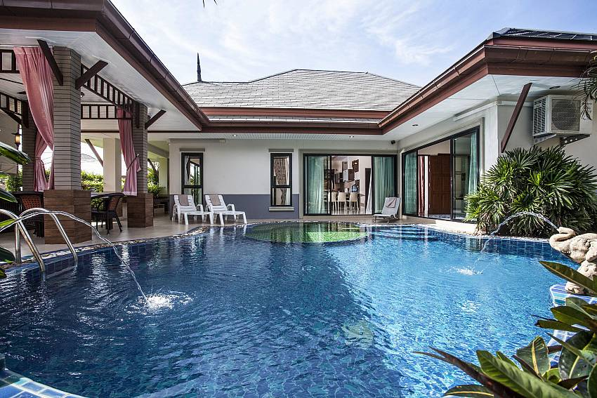 Large swimming pool in front of the house Of Thammachat P2 Laima Pool
