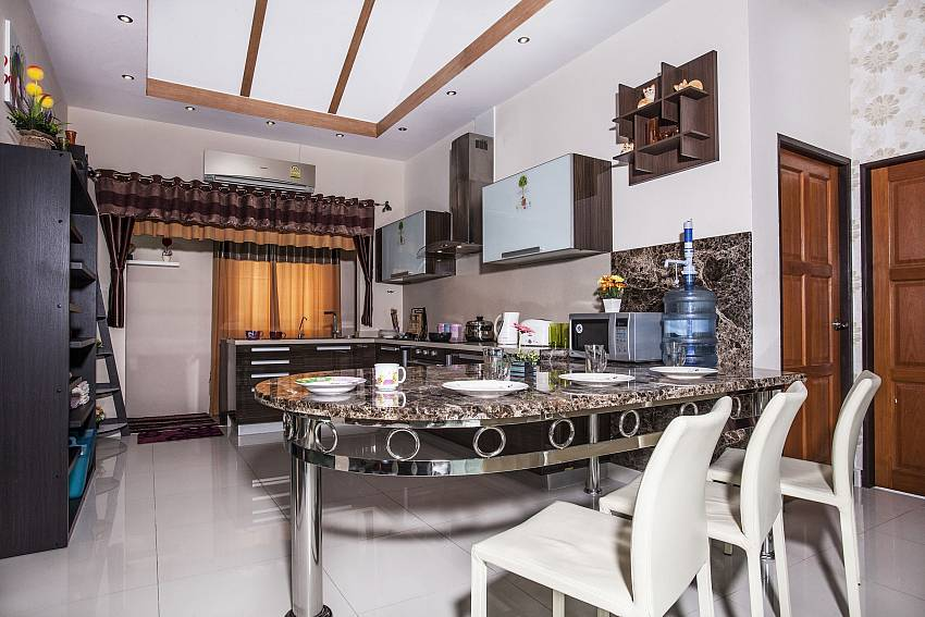 Dinning table near the kitchen Of Thammachat P2 Laima Pool