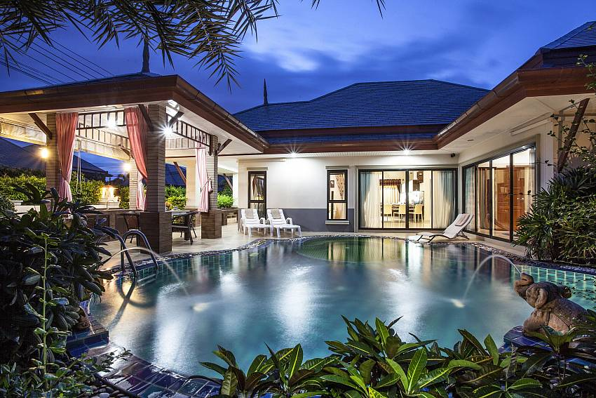 Large home at night time Of Thammachat P2 Laima Pool