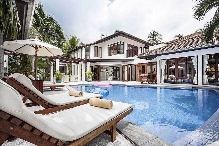 Sun bed near the pool Of Villa Kanya