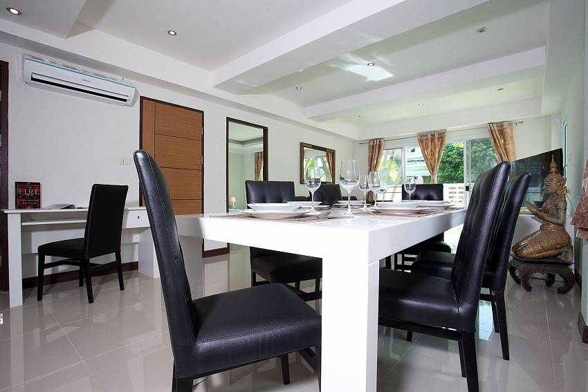 Open plan dining and living area at Villa Phawta West Phuket