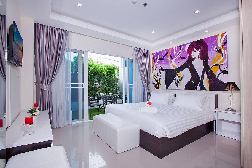 Bedroom overlooking outside of Fantasia Apartment (First)