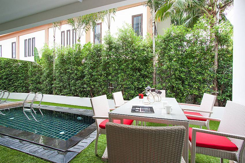 Al fresco dining by your private pool at Fantasia Apartment in Pattaya