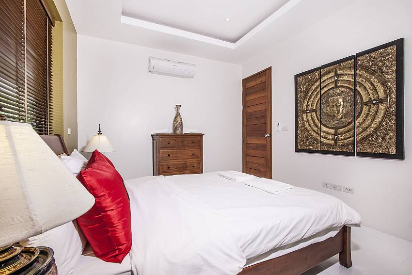 Bedroom is decorated with picture of art of  Banthai Villa 11 (Third)