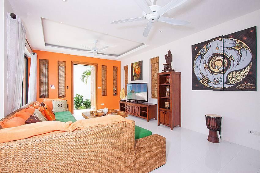 Spacious living ares with TV at Banthai Villa 11 Samui