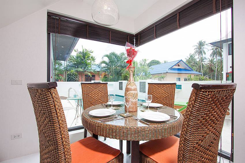 4-seat dining table with pool view at Banthai Villa 11 Samui