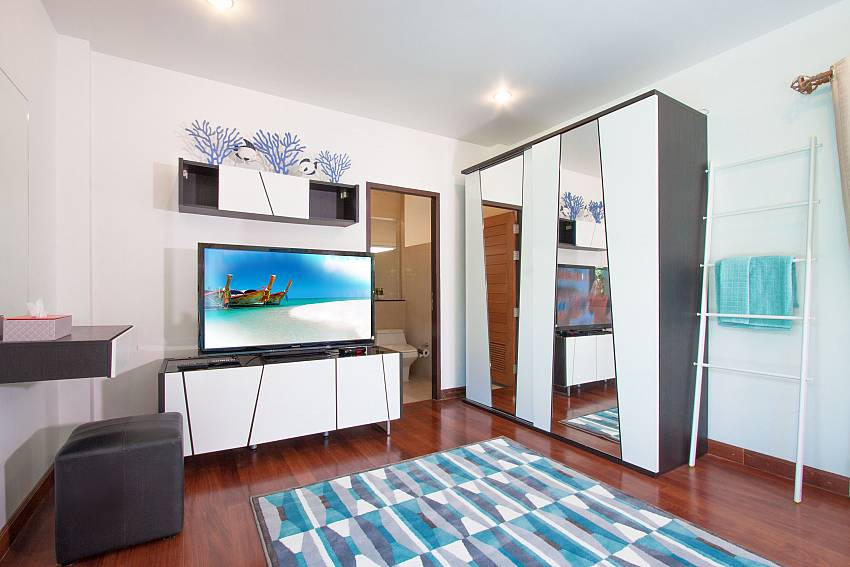 TV with wardrobe in the bedroom of Villa Kalasea