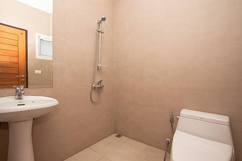Shower with toilet and basin wash of Villa Kalasea