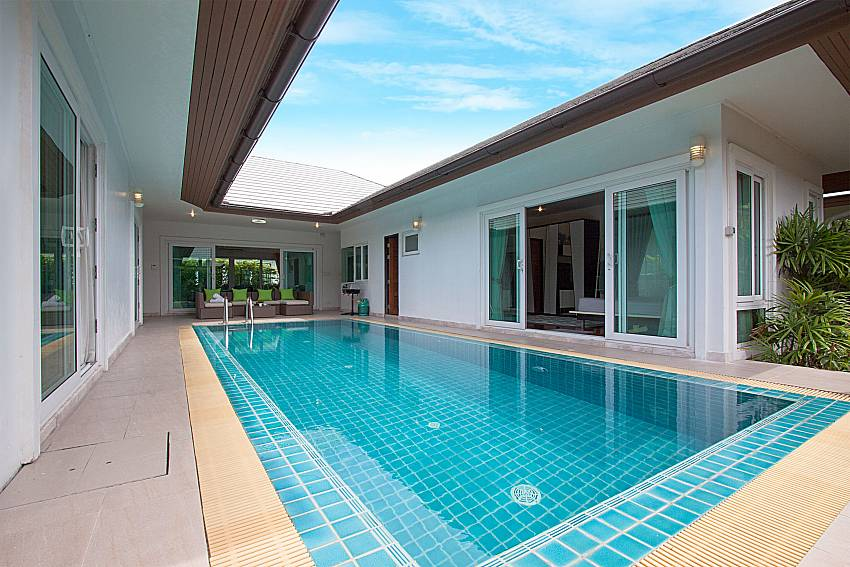 Swimming pool in the middle of the house overlooking scenery of Villa Kalasea