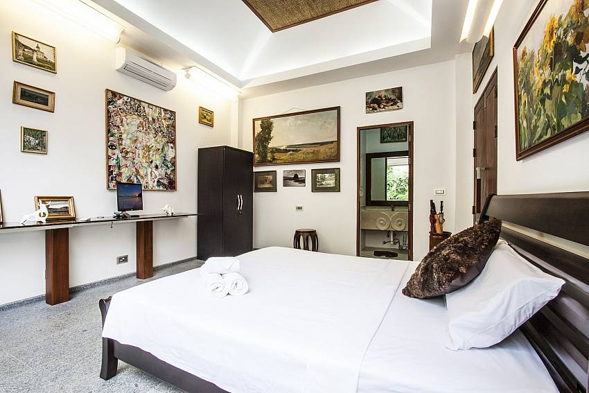 Bedroom is decorated with beautiful picture of Namuang Villa (Third)