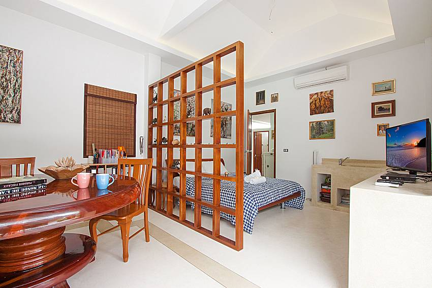 Bedroom with seat and table Namuang Villa