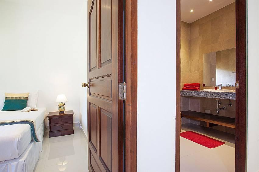 Bed and bathroom close together at Baan Maenam No.3 in Koh Samui