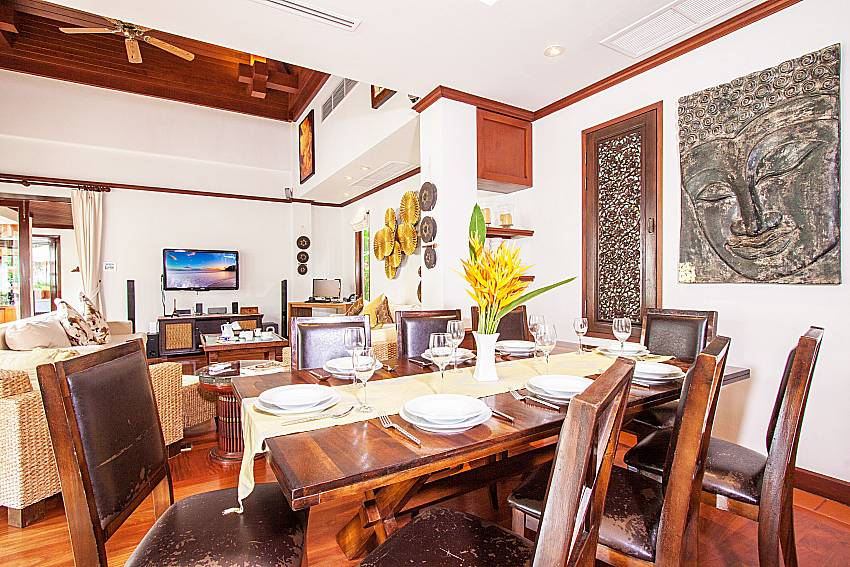 Dinning table is decorated with pictures of art of Baan Pasana