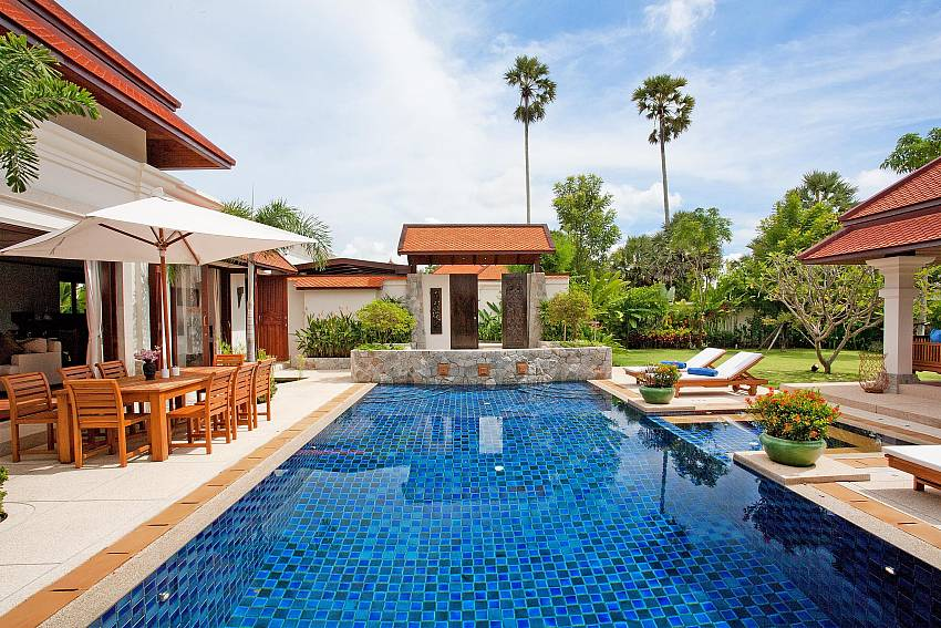 Swimming pool with dinning table of Baan Pasana